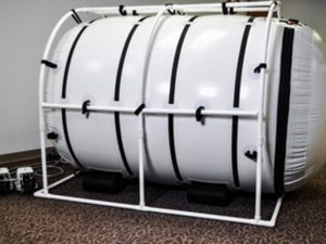 Wheel chair hyperbaric chamber